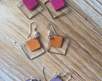 Leather and silver pierced earrings