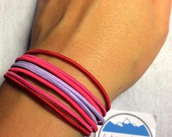 Pink cord bracelet adjustable elastic.