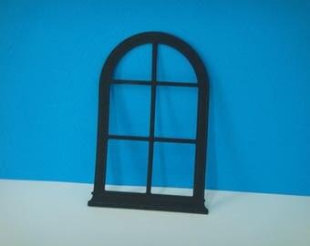 Cut little black arch window