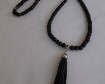 Buddhist rosary Mala, wooden beads and jade, black and green.