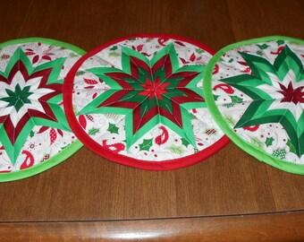 Three machine quilted kitchen hot pads