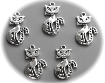10 charms cats eyes in almonds in silver