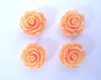 Set of 4 T 5 coral colored flower cabochons