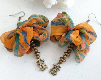 """Earrings """"The year of the Dragon"""" silk sari recycled India, bronze findings and charms."""