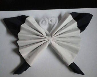 Black and White Butterfly shaped napkin folding
