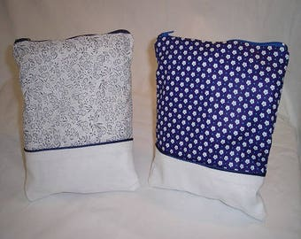 Two-tone blue and white pouch with d blue piping