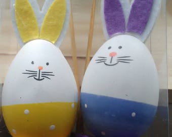 wooden stick in the shape of Easter Bunny in yellow, orange or green and white color for Easter arrangement