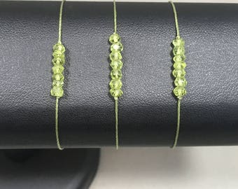 Ajustable bracelet with 7 small Peridots