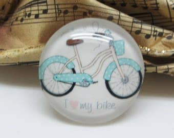 2 14 mm glass cabochon has blue bicycle/bike - 14 mm