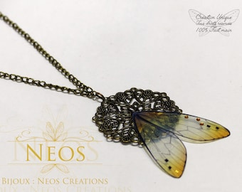 Filigree fairy necklace on its stand