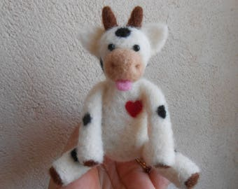 Whimsical cow felted.