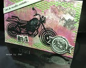 """Black motorcycle card: """"to new adventures""""."""