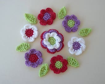 7 flowers red, purple and white and 6 green leaves crochet