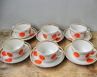Vintage  porcelain  tea set ,white and red polka dot,6 cups,demitasses with saucers