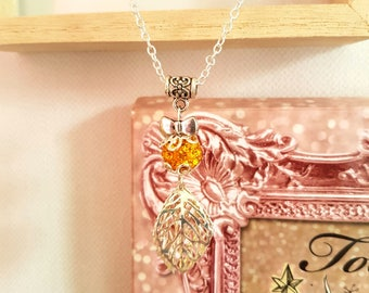 Pendant with bead and charms