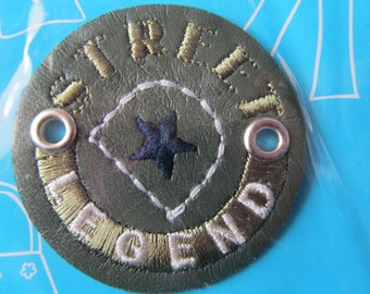 Fusible decorative pattern depicting a Street Legend badge - can be stitched