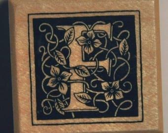 Stamp - wood letter f.
