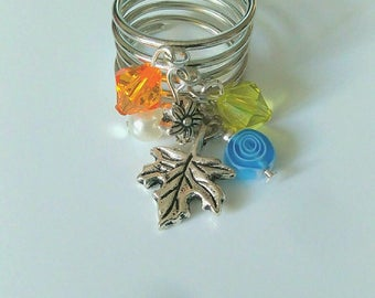 Silver plated ring. Pendants blue, orange, green, and leaf pendant.