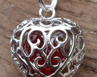 Necklace and pendant, Choker the red with silver heart pendant Tibetan and red beads inside.