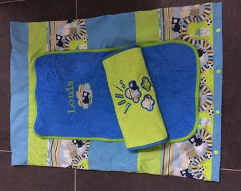 Changing mat with his two custom diapers protected