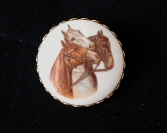 Vintage brooch with horses print