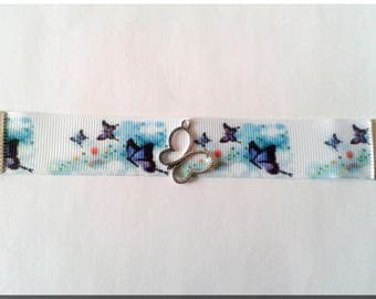 White fabric soared purple butterflies and Butterfly V2 charm bracelet