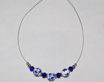 Porcelain and blue swarovski crystal wired necklace