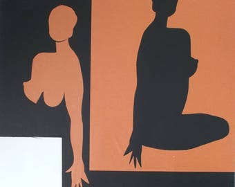 paper cut portrait in black and orange seated nude woman