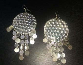 Earrings have coins charms