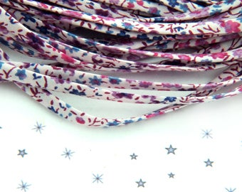 genuine Liberty spaghetti cord background off-white purple flower motifs