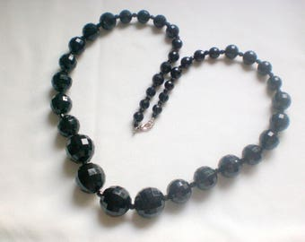 Black beaded necklace has faceted