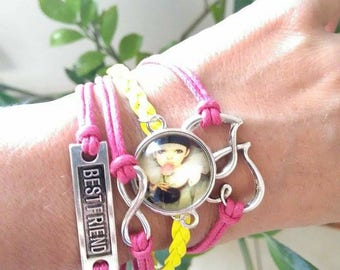 A lovely pink and yellow bracelet, charms and 20mm cabochon