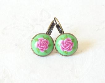 Earrings, earrings, rose pink sleepers and foliage.