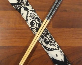 Case for chopsticks and chopsticks assorted black and silver
