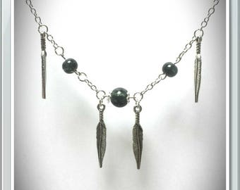 Long silver necklace with feathers