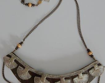 Garland and bronze chain bib necklace
