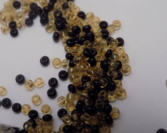 set of pretty gold/black seed beads.