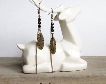 Earrings long and thin black bronze feathers