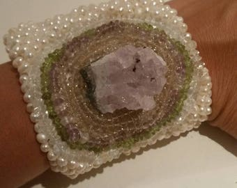 Braccialle embroidered with freshwater pearls and precious stones