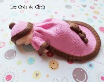 baby girl sleeping in his sleeping bag polymer clay.