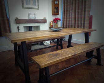 Handmade industrial plank top dining table with benches