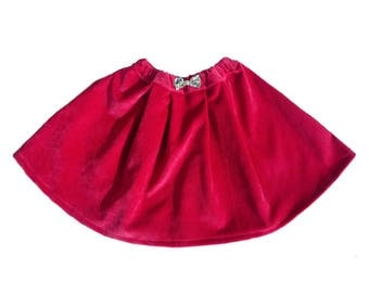 Girl pleats raspberry velvet skirt.
