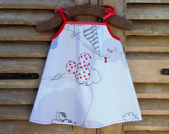Baby dress with straps in red and grey cotton.