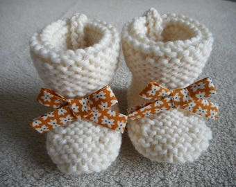 Mustard bow and ecru wool baby booties.