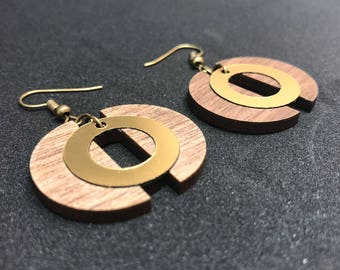 The half circles of wood and acrylic earrings
