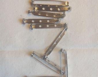 Set of 10 silver pins