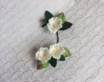 White flower branch hair clip