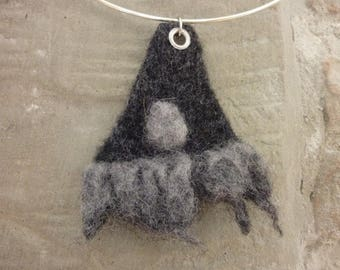 Grey and black triangular pendant made from felted wool