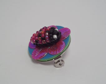 Ladybug on iridescent red flower brooch