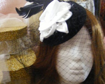 Black pillbox fascinator with veil